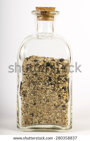 Sand in a bottle - stock photo