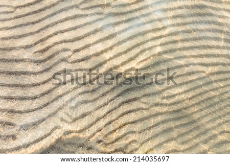 sand on the sea shallow water of Baltic sea - stock photo