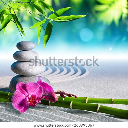 sand, orchid and massage stones in zen garden  - stock photo