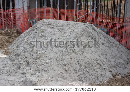 Sand pile at the a construction site. Piles of sand. - stock photo