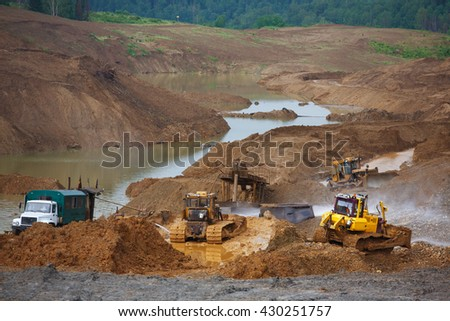 Sand pit. Sand special for construction. Pit full of fine sand and truck tracks. Gold mining - stock photo