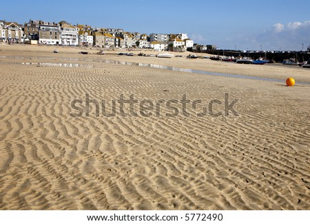 Sand ripples on the harbour beach in St. Ives, Cornwall. - stock photo