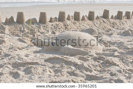 Sand sculpture of a sea turtle. - stock photo