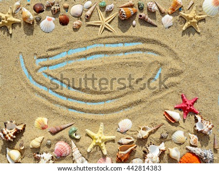 Sand, seashells and starfish on a blue wooden background - stock photo