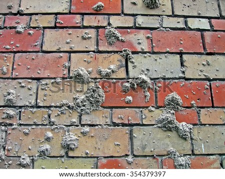 sand spots on brick wall, construction industry details - stock photo