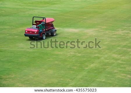 sand spray car Maintenance the football field. - stock photo
