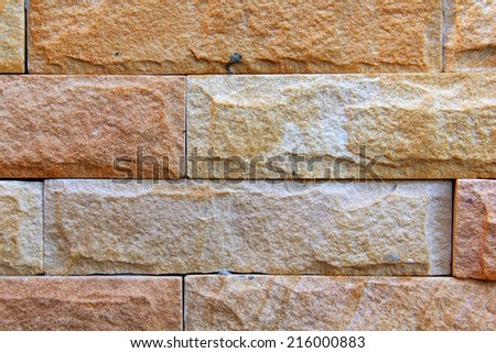 sand stone wall Background of decorate brick tile - stock photo