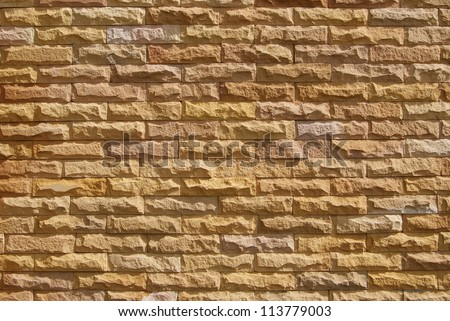 Sand stone wall surface, background of decorate - stock photo