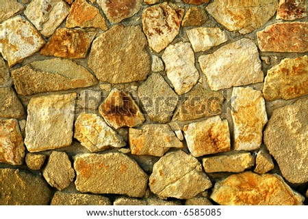 Sand stones wall. Background or texture. - stock photo
