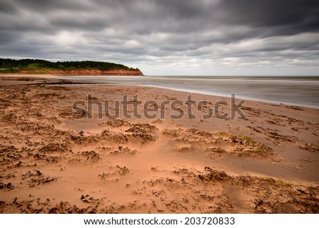 Sand storm on the red beach at Rustico as hurricane approaches - stock photo