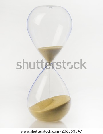 Sand Streams in a hour glass/Hour Glass/Vintage hand blown hour glass with sand streaming marking time - stock photo