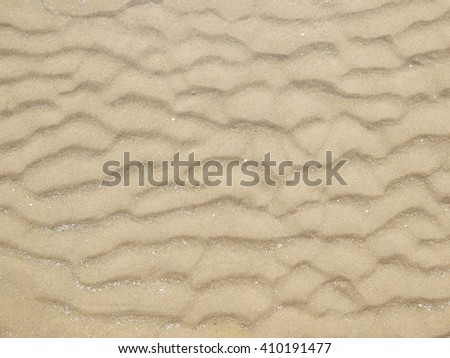 Sand texture.Dented wave of the blow of the wind - stock photo