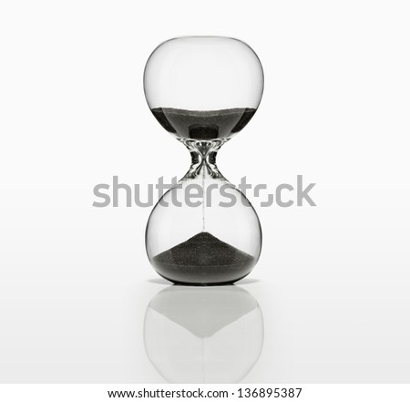 Sand Timer with black sand on white. With Clipping Path, - stock photo