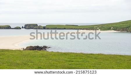 Sand tombolo (causeway) to St. Ninian's Isle on the southwest coast of the main Shetland island, which is located northeast of Scotland, United Kingdom - stock photo