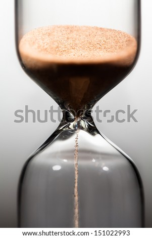 sand watch macro closeup flow - stock photo