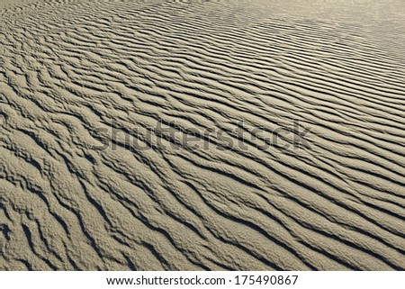 sand waves and sand structure outdoors on a sunny day - stock photo