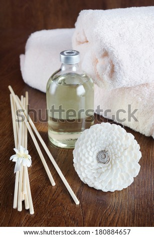 Sandal oil and sticks for aromatherapy - stock photo