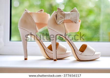 Sandals are a bride on the window - stock photo