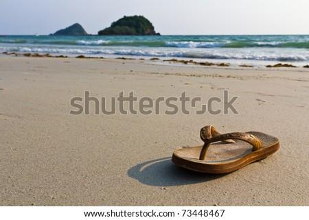 Sandals, flip-flops on the beach - stock photo