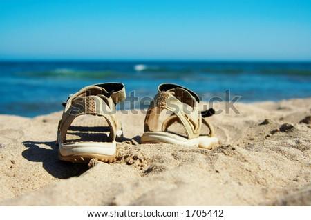 Sandals going to swim - stock photo