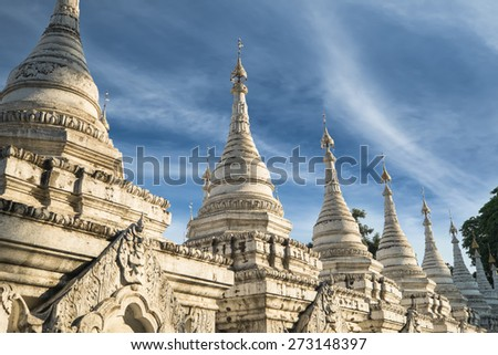 Sandamuni Pagoda with row of white pagodas. Amazing architecture of Buddhist Temples at Mandalay. Myanmar (Burma) travel landscapes and destinations - stock photo
