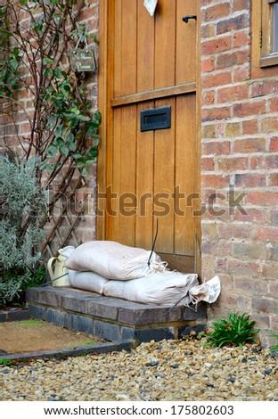 Sandbag barrier in doorway - stock photo