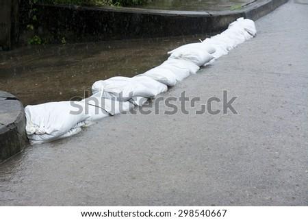 Sandbags to prevent flooding homes - stock photo