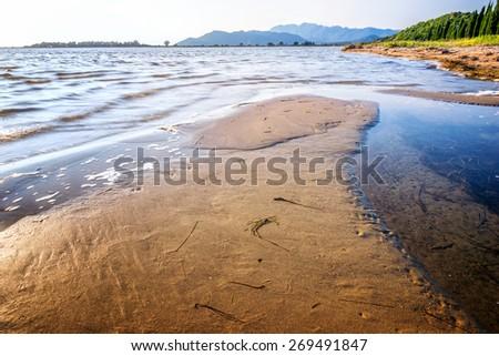 Sandbar on the shore by the sea - stock photo