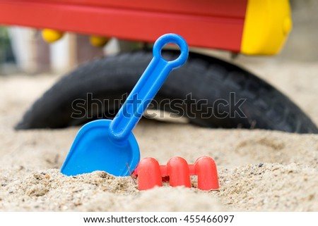 Sandbox with sand toys for children - stock photo