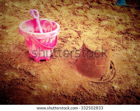 Sandcastle and bucket and spade - stock photo