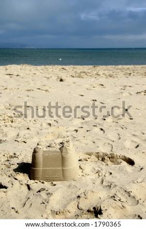 Sandcastle at beach - stock photo