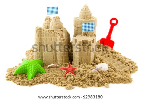 Sandcastle at the beach on vacation isolated over white - stock photo
