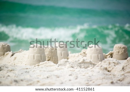 Sandcastle on the coast of ocean - stock photo