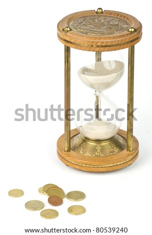 Sandglass and euro coins isolated on white background - stock photo