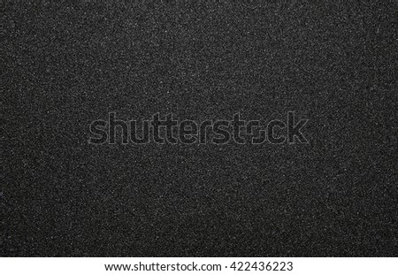 Sandpaper texture for Background - Black rough sandpaper sheet,sandpaper close up - stock photo