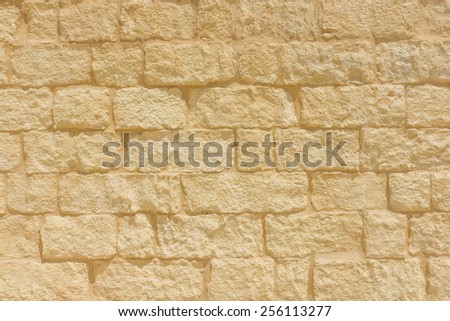 Sandstone brick wall background. - stock photo