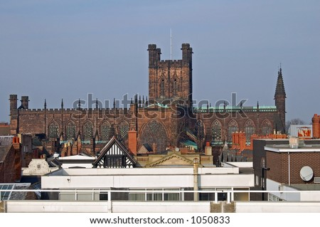 Sandstone Cathedral viewed rising above the rooftops of Chester - stock photo