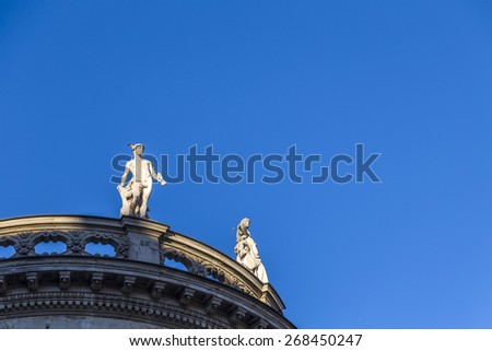 sandstone statues in classicism style at the roof of an old building at Max Josephs Platz in Munich - stock photo