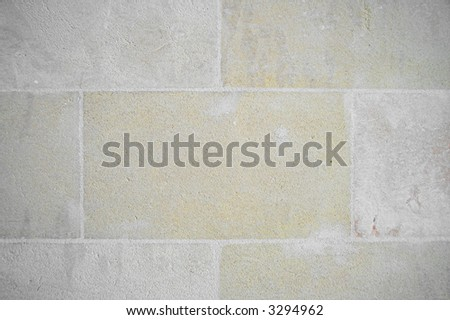 Sandstone wall in tiles - stock photo