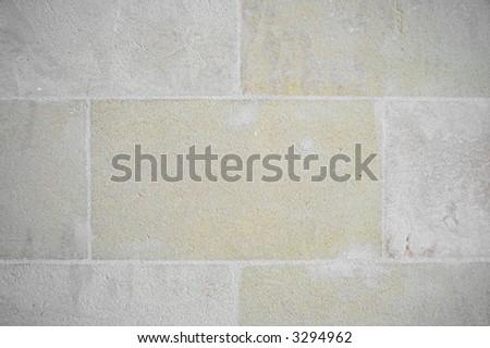 Sandstone wall in tiles - stock photo