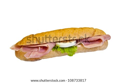 Sandwich - a bread roll with ham, eggs and lettuce fillings. - stock photo