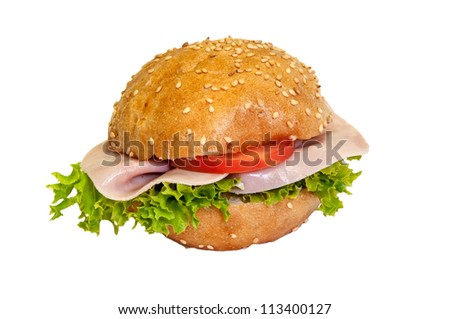Sandwich - a bread roll with ham fillings. - stock photo