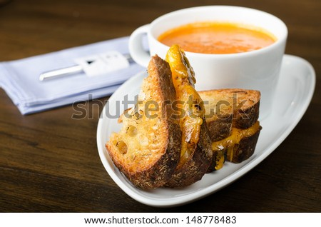 Sandwich and cream of pumpkin soup  - stock photo