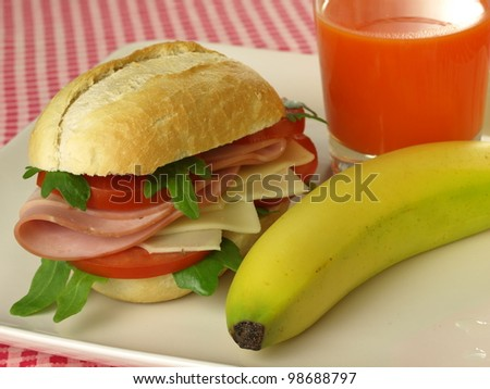 Sandwich, fresh fruit and juice - stock photo