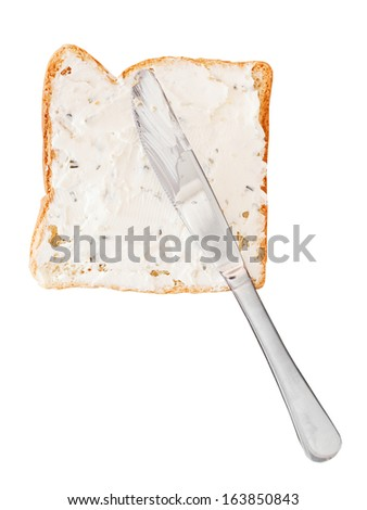sandwich from toast and soft cheese with herbs, table knife isolated on white background - stock photo