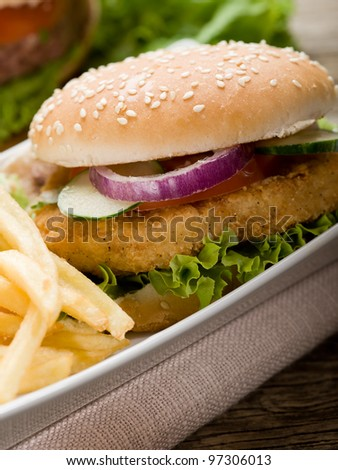 sandwich hamburger with chicken  potatoes and salad - stock photo