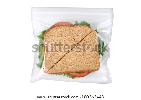 Sandwich in plastic bag, cutout on white background - stock photo