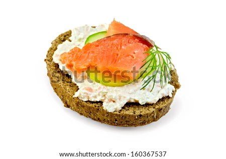 Sandwich of rye bread with cream, cucumber, dill and salmon isolated on white background - stock photo