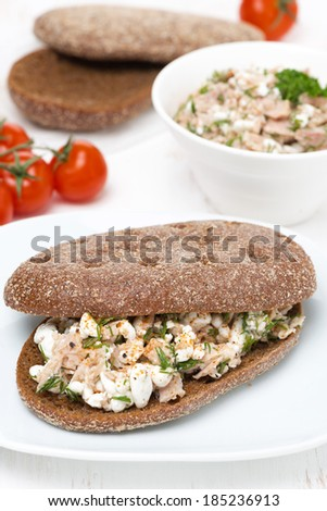 sandwich of rye bread with tuna, homemade cheese and dill, close-up - stock photo
