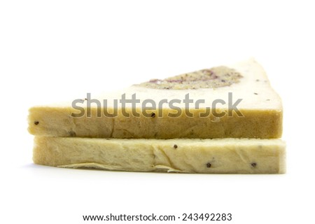 Sandwich sliced whole wheat bread with banana gold edge on white background - stock photo